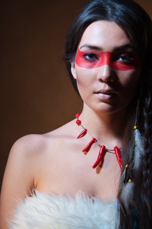 indian brave: American Indian with paint face camouflage - studio photo with professional makeup Stock Photo