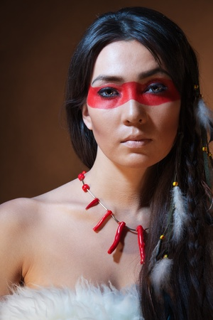 American Indian with paint face camouflage - studio photo with professional makeup photo