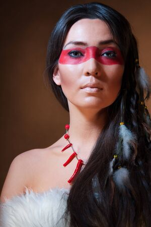 native indian: American Indian with paint face camouflage - studio photo with professional makeup Stock Photo