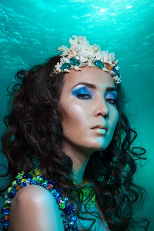 Mermaid with crown of corals - beauty portrait of a woman photo