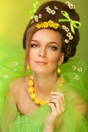waited: Long waited spring - beauty portrait attractive woman with bows and flowers in her hair and dress, with professional hairstyle and make up