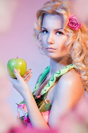 Bible Eva woman holding green apple photo