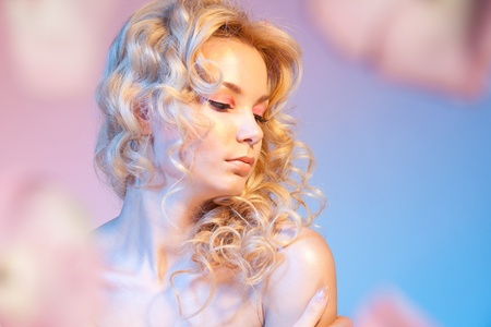 Shy beautiful bloody woman with curly hair and naked shoulders photo