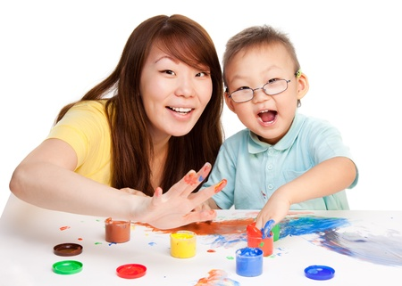 Mother and kid spending some time together painting with their hands Stock Photo - 9486866