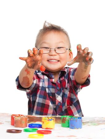 dirty hands: Little Chinese boy showing his dirty hands and smiling looking at camera Stock Photo