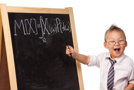 Young boy playing a big scientist standing by blackboard with mathematical expectation formula written on it