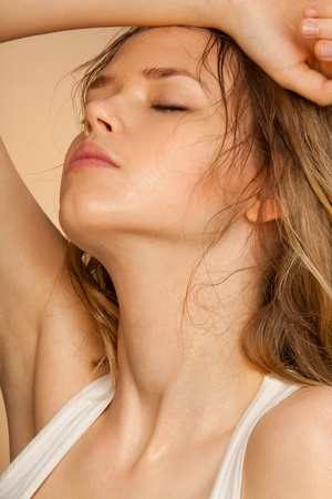 Hit girl tired from recreation sweeping sweat from her elbow with closed eyes Stock Photo - 9487125