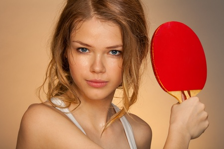 repel: Happy young beautiful girl playing ping pong Stock Photo