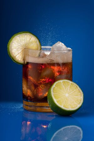 sprinkling: Sprinkling cold cola with lime and ice Stock Photo
