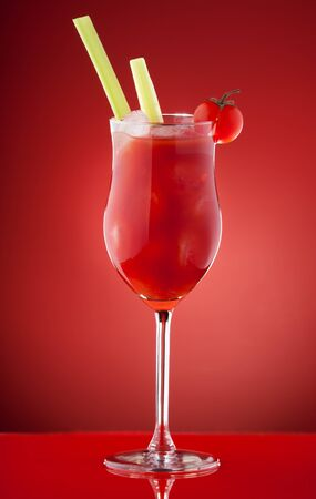 Bloody Mary cocktail in glass with cedar and cherry tomato photo