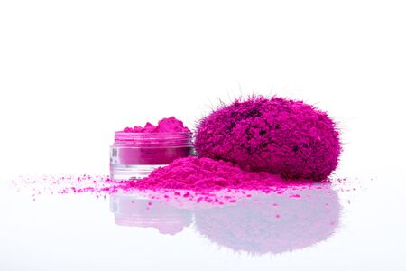 eyeshades: Jar with vivid makeup shadows and pile of pink powder with fuzy applicator Stock Photo