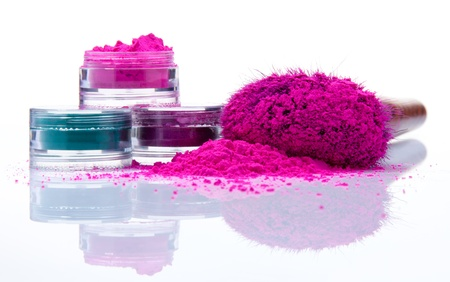 cosmetic products: Makeup powder of different colors and brush