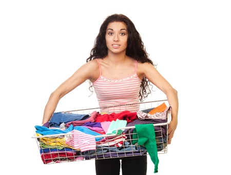 Woman holding heavy basket of clothes, isolated on white photo