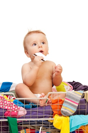 secure shopping: Baby with clothes and credit card on white