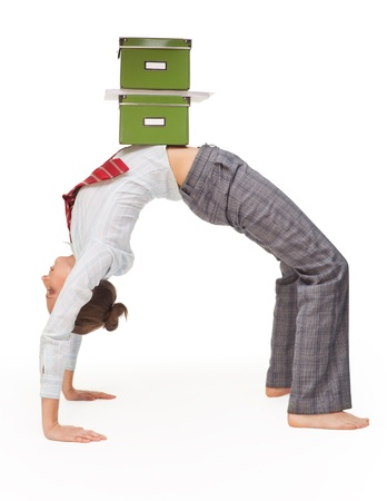 Business woman in flexible pose (bridge pose) with boxes with document on top photo