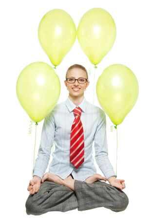 business woman sitting in lotus pose and flying on air balloons, wearing glasses, with wide smile photo