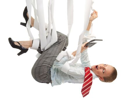 Crazy accountant messed up in checks with calculator hanging, in formal clothes Stock Photo - 10832692