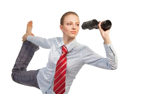 Business woman standing in flexible pose and looking in binocular - waist up  portrait photo