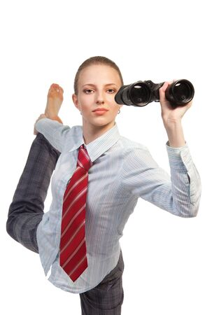 Business woman standing in flexible pose and looking in binocular, front view photo
