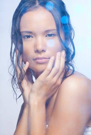 Beauty shoot of calm Asian woman with wet hairs in shower photo