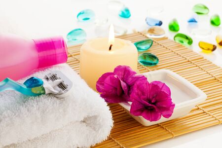 All for relaxation in bathroom - flowers, towel, gel, candle e.t.c. photo