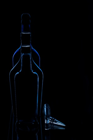 Dark silhouetted  shape of a bottles with bottle plug on dark Stock Photo - 11749516