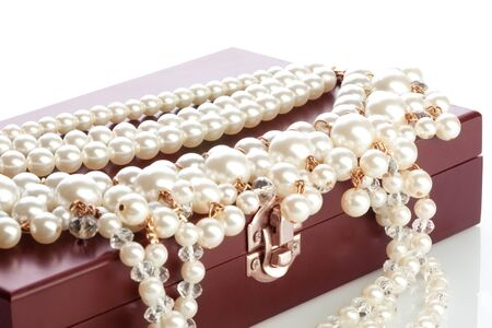 Wood bow with jewelry and pearl necklace Stock Photo - 11750032
