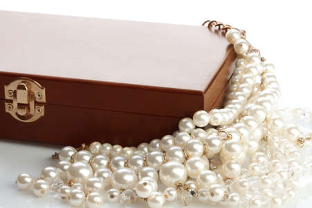 Wooded bow with jewelry and pearl necklace on white background Stock Photo - 11753511