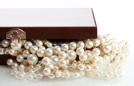 string of pearls: Wooded bow with jewelry and pearl necklace on white