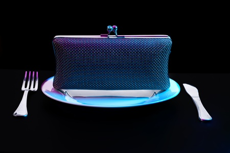 Plate and stylish metal shiny purse with table fork and knife Stock Photo - 11753329