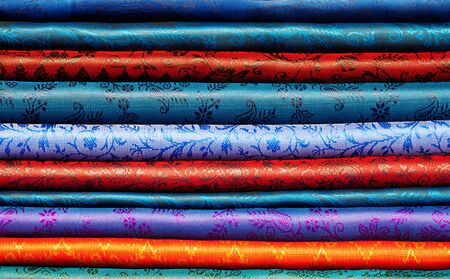 Folded fabric of different colors with ornament prepared for selling Stock Photo - 11754110