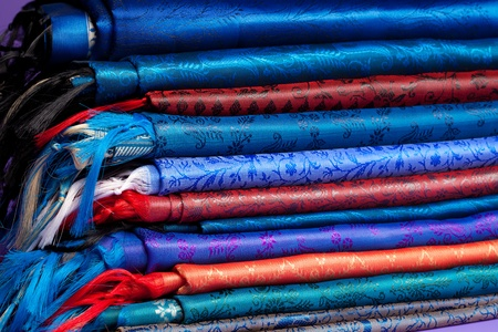 Fabric of different colors folds with fringe in store in store Stock Photo - 11754129