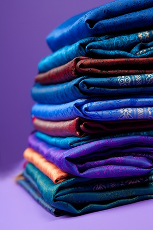 Pile of silk fabric of different color with beautiful ornament Stock Photo - 11753951