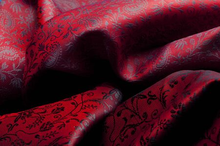 lining: Expensive red fabric with complex ornament