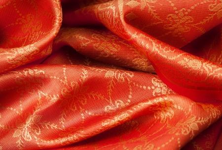 silk scarf: Folded orange fabric with Indian ornament