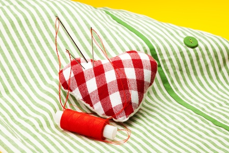 stitchcraft: needle-holder in for of heart  with cushion Stock Photo