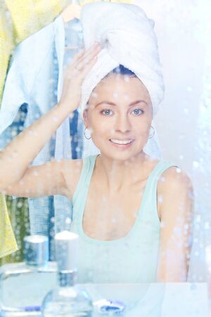 Young beautiful woman After morning shower with towel photo