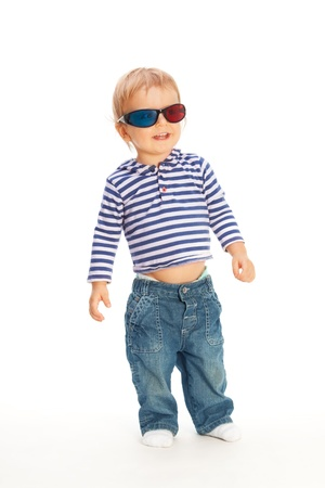 Cute happy kid in 3d glasses walking photo