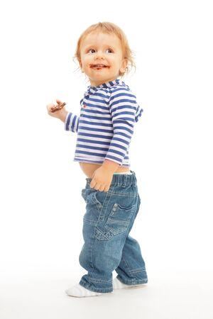 Happy cute kid with chocolate walking and smiling photo