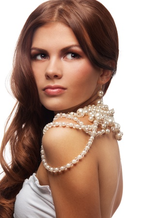 Portrait of young woman with  pearls necklace turning back Stock Photo - 11753761