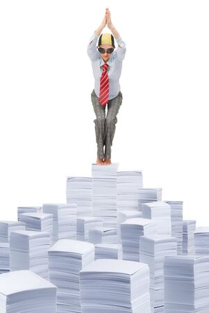 Woman in business clothes with tie jumping in pool made of paper piles photo