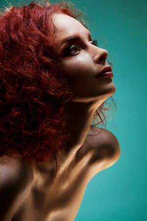 smooth hair: Beauty portrait of woman with red curly hair on blue