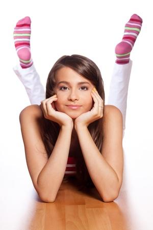 calcetines: Adolescente positivo, pero insatisfecha por la que se en el piso Foto de archivo