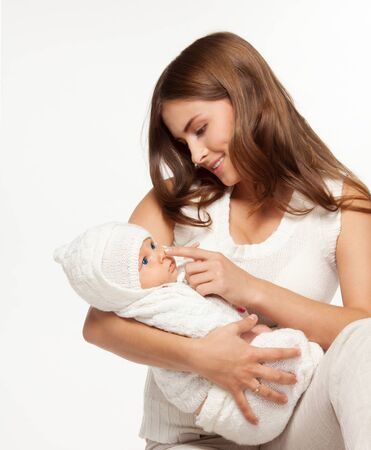 mom holding baby: Mother playing with her adorable little baby