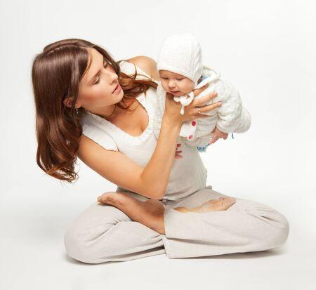 causal: Mother sitting in lotus yoga pose