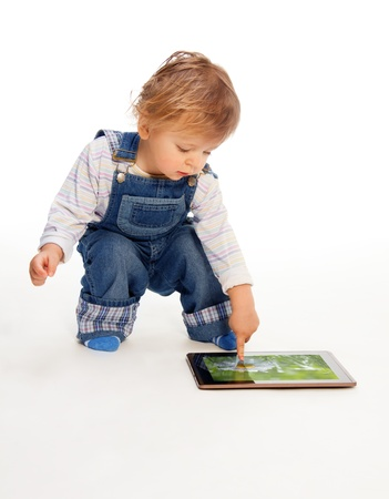 young kid touching tablet pc (image on the screen from my portfolio) photo