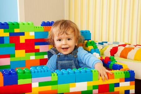 blue jeans kids: Constructing with toy blocks is fun - kid playing with toy plastic blocks Stock Photo
