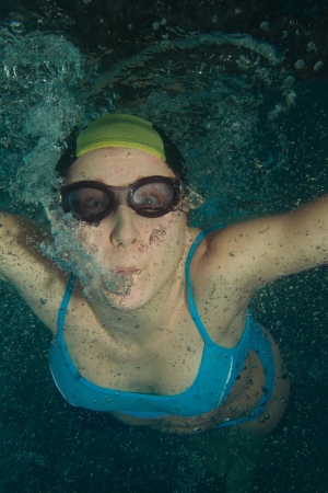 underwater woman: Woman swimmer underwater shoot in glasses and cap Stock Photo