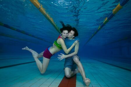 Boyfriend kissing his lover - underwater swimming and having fun photo