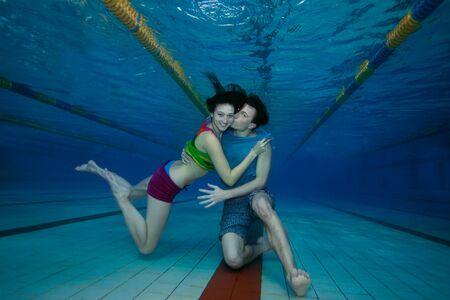 underwater woman: Boyfriend kissing his lover - underwater swimming and having fun